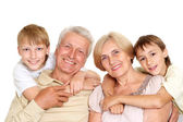Grandparents with their fun grandchildren — Stock Photo