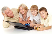 Grandchildren with their fine granddad and granny — Stock Photo