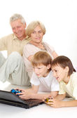Grandchildren with their glorious granddad and granny — Stock Photo