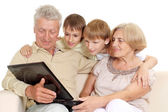 Granddad and granny with their gorgeous grandchildren — Stock Photo