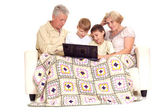 Grandfather and granny with their attractive grandchildren — Stock Photo