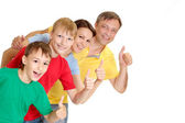 Nice family in bright T-shirts — Stock Photo