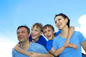 Smiling family having fun — Stock Photo