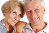 Glad old couple at home — Stock Photo
