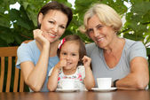 Happy family on the veranda — Stock Photo
