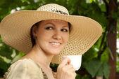 Good lady on the veranda — Stock Photo