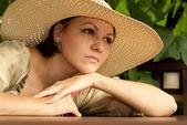 Nice lady on the veranda — Stock Photo