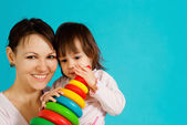 Smile Caucasian lady with a child — Stock Photo