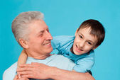 Caucasian elderly man with a youngster — Stock Photo