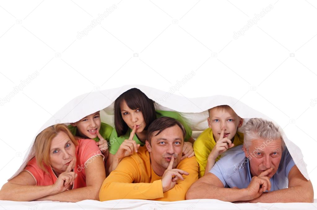 Portrait of a big family lying on white — Stock Photo #12842105