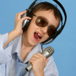 Stock Photo: Caucasihandsome young mwith headphones and microphone po
