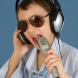 Caucasian handsome young boy with headphones and a microphone po — Stock Photo #12887676