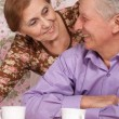 Pretty older woman and her husband — Stock Photo #12887775