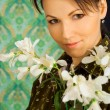 Beauteous woman with flowers — Stock Photo
