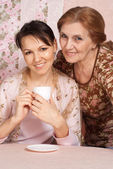 Beautiful older woman with daughter — Stock Photo