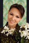 Nice woman with flowers — Стоковое фото