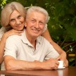 Happy elderly couple  on the nature — Stock Photo