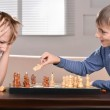 Two boys playing chess — Stock Photo #29178441