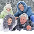 Happy family in winter outdoors — Stock fotografie