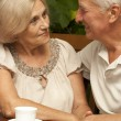 Adorable elderly couple sitting on the veranda — Stock Photo