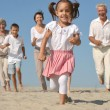 Friendly family running — Stock Photo #29179079