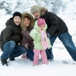 Family against the backdrop of the snow — Stock Photo