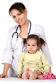 Little girl and pediatrist — Stock Photo
