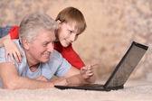 Hombre y su nieto — Foto de Stock