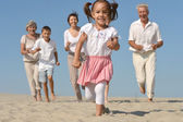 Friendly family running — Stock Photo