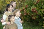Friendly family of four — Stock Photo