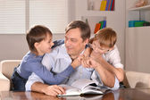 Happy father and his two sons — Stock Photo