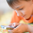 Young boy using mobile phone — Stock Photo