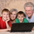 Mature couple and their grandchildren — Stock Photo