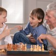 Happy family at a chess — Stock Photo