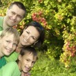 Happy family in green shirts — Stock Photo