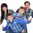 Portrait of cheerful family of four — Stock Photo