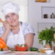 Grandma preparing dinner — Stock Photo