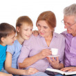 Grandparents with their grandchildren — Stock Photo