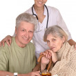 Portrait of doctor and sick older caucasian couple — Stock Photo