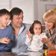 Family with cheerful children — Stock Photo #29181879