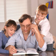 Father and his two sons  at home — Stock Photo