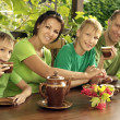 Happy family  drinking tea — Stock fotografie