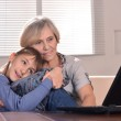 Boy and grandmother with laptop — Stock Photo #29183055