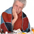 Elderly caucasimtreated by medicines — Stock Photo #29183511