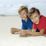 Children lie on the sand — Stock Photo #29183761