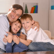 Happy father hugging his sons — Stock Photo #29184007