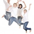 Cheerful family jumping — Stock Photo #29184013