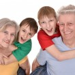 Children and their grandparents — Stock Photo #29184063
