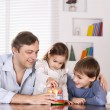 Father and his children playing — Stock Photo