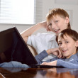 Two boys with a laptop — Stock Photo